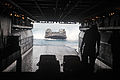 US Navy 100828-M-6539J-014 A landing craft air cushioned prepares to enter the well deck of USS Kearsarge (LHD 3) during a deployment onload off the coast of Onslow Beach, Camp Lejeune, N.C.jpg