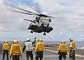 US Navy 100913-N-5538K-205 Flight deck personnel assigned to the forward-deployed amphibious assault ship USS Essex (LHD 2) watch a CH-53E Sea Stal.jpg