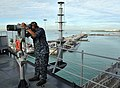 US Navy 110312-N-0864H-280 Operations Specialist 3rd Class Anthony Wilson looks through the.jpg