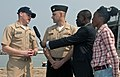 US Navy 110717-N-XK513-055 Lt. j.g. Adam Cole, left, future operations officer for High Speed Vessel Swift (HSV 2), responds to questions from loca.jpg