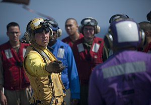 US Navy 120103-N-PB383-286 Aviation Boatswain's Mate (Handling) 2nd Class Mark Thornton addresses Sailors and Marines during a flight deck fire fig.jpg