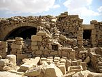 Ruins of a building of white stone.