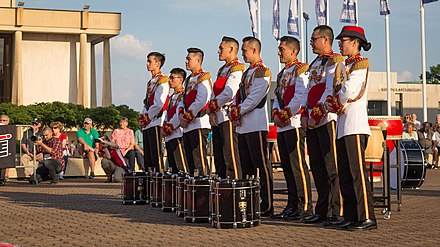 The Singapore Armed Forces Band's drumline at the Virginia International Tattoo in 2017. VATatt - Singapore Armed Forces Band (34356175666).jpg