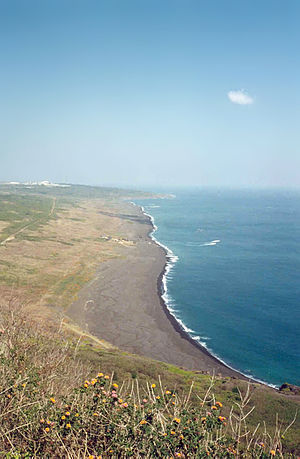 Planning for the Battle of Iwo Jima - View of the invasion beach from the top of Mount Suribachi, February 2002