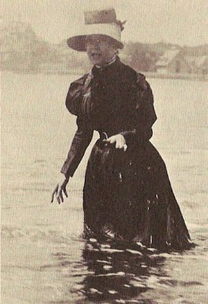 Virginia Fair Vanderbilt - Virginia wading in the water at Bailey's Beach