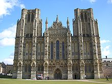 The facade of Wells, unlike Exeter, presents a unified and balanced composition. However, the towers look truncated because they were intended to have spires that were not built.