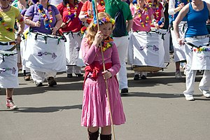 West End Festival - A girl holds up a banner leading the SheBoom percussion ensemble during the West-End Festival opening parade in June 2008.