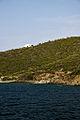White Greek villa near the cliffs of Ammouliani.jpg
