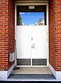 White door on brick wall.jpg