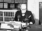Winston Churchill at a BBC microphone about to broadcast to the nation on the afternoon of VE Day, 8 May 1945. H41843.jpg