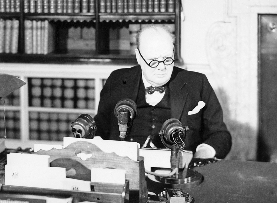 Winston Churchill at a BBC microphone about to broadcast to the nation on the afternoon of VE Day, 8 May 1945. H41843
