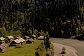 Wooden houses along riverside.jpg
