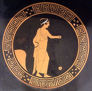 Yo-yo - Boy playing with a terracotta yo-yo, Attic kylix, c. 440 BC, Antikensammlung Berlin (F 2549)