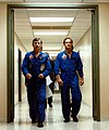 Young, left, and Crippen walk down the hall to don their pressure suits on launch day.jpg