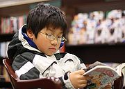 A young boy reading a Black Cat manga in a U.S. bookstore