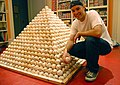 Zack Hample posing with a pyramid of baseballs.jpg