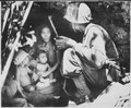"""A member of a Marine patrol on Saipan found this family of Japs hiding in a hillside cave. The mother, four children an - NARA - 532380.tif"