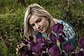 День Вишиванки. Молода україночка у вишитій синій сукні серед квітів 21.jpg