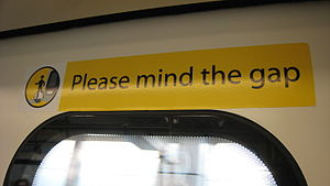 "Mind the gap - A former ""Please mind the gap"" sign on a Hong Kong MTR train"