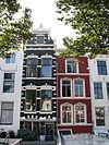foto van Huis met derde kwart 19e eeuw gepleisterde lijstgevel