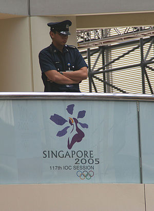 117th IOC Session - Tight security was highly visible during the 117th IOC Session. A police officer stood watch on the fourth floor of the Raffles City complex where the session was taking place.