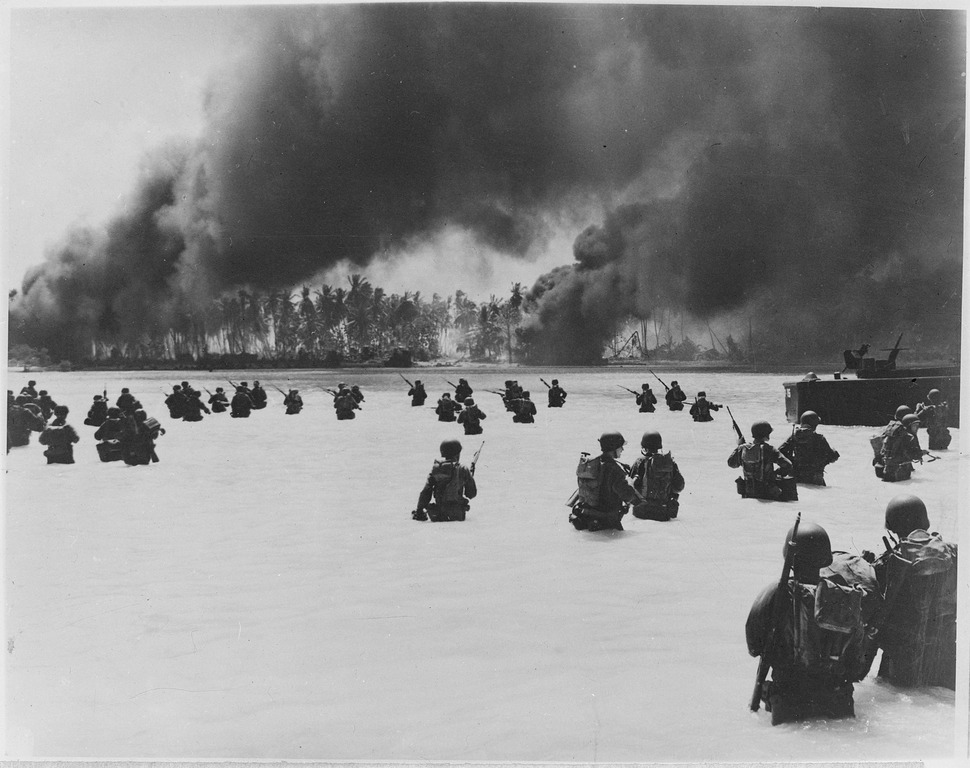 165th Infantry assault wave attacking Butaritari, Yellow Beach Two, find it slow going in the coral bottom waters.... - NARA - 531172