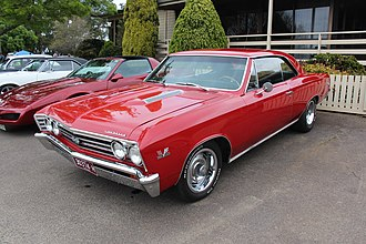A red 1967 Chevrolet Malibu 1967 Chevrolet Chevelle SS 396 Sports Coupe (15452516841).jpg