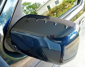 Honda Ridgeline - The small vortex generators on top of the side-view mirror smooth airflow and reduce wind noise.