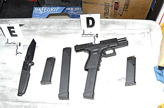 2011 Tucson shooting - Weapons recovered from perpetrator; knife, four magazines, Glock 19