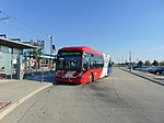 3500 South MAX bus at its shelter at Millcreek station, Aug 16.jpg