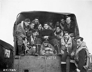 433 Tactical Fighter Squadron - Aircrew of No. 433 (Porcupine) Squadron, RCAF: en route to their Handley Page Halifax B.III aircraft before taking off to raid Hagen, Germany, December 2, 1944