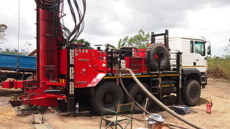 """Cominco Resources - An 8"""" coring tool fitted to a drilling rig at the Hinda Mine Site"""