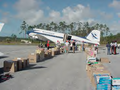 A DC3 brings joy and Christmas gifts to Abaco.png