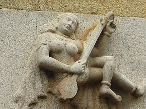 Veena - A Hindu temple relief showing a veena player (Akilandeswari Temple).