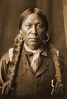 A Jicarilla Man, 1904, Edward S. Curtis (sepia restored).jpg