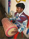 A Santal drummer playing Tumda.jpg