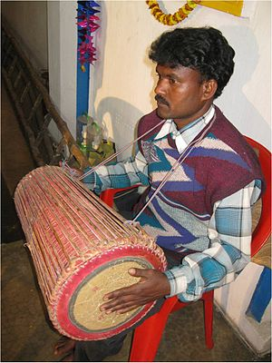 Tumdak' - A Santal drummer playing a tumdak'