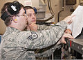 A U.S. Air Force staff sergeant, left, serving as an instructor, helps Senior Airman Joseph Szymanski, with the 361st Training Squadron, check an electrical wiring diagram to troubleshoot an electrical problem 110608-F-NS900-013.jpg