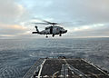 A U.S. Navy SH-60 Seahawk helicopter assigned to Helicopter Sea Combat Squadron (HSC) 21 conducts flight operations June 25, 2013, aboard the guided missile frigate USS Thach (FFG 43) while underway in 130625-N-UL721-143.jpg