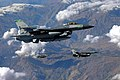 A US Air Force (USAF) F-16CG Fighting Falcon aircraft assigned to the 180th Fighter Wing (FW) Ohio (OH), Air National Guard, flies with two USAF F-16CJ Fighting Falcon aircraft assi - DPLA - 01072dc3d4a9c14ae032888d4ca1c8a0.jpeg