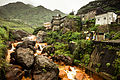 A contaminated river runs through (15017104296).jpg