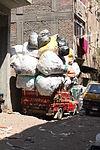 A garbage truck in Streets of Manshiyat Nasser, Mokattam, Cairo.JPG
