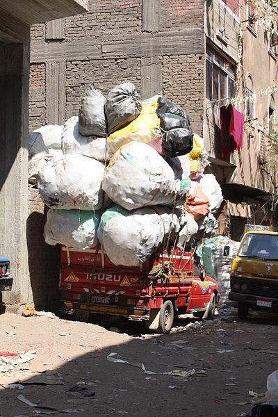 File:A garbage truck in Streets of Manshiyat Nasser, Mokattam, Cairo.JPG