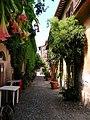 A leafy street in Rome (9026972436).jpg