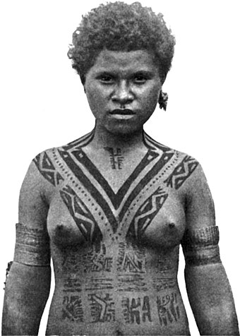 Tattooing among females of the Koita people of Papua New Guinea traditionally began at age five and was added to each year, with the V-shaped tattoo on the chest indicating that she had reached marriageable age. Photo taken in 1912. A marriageable girl.jpg