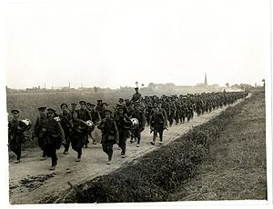 19th (Western) Division - Men of the 8th (Service) Battalion, North Staffordshire Regiment (Prince of Wales's Own) on the march near Merville, France, 5 August 1915.