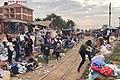 A train arrives at Kireka halt in Kampala, as traders make way for its arrival.jpg