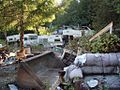 Abandoned vehicles, scattered debris at Tully Creek (3906944748).jpg