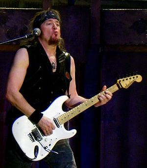 Adrian Smith - Smith performing with a Jackson guitar.