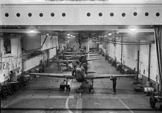HMS Argus (I49) - Five Sea Hurricanes and a single Seafire lined up in the hangar, c. 1942–44